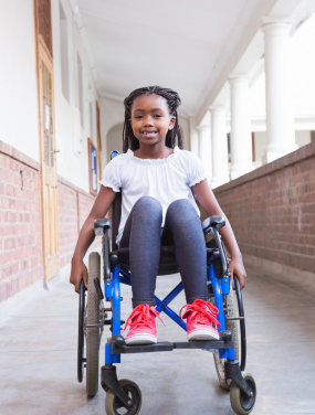 girl in wheelchair smiling