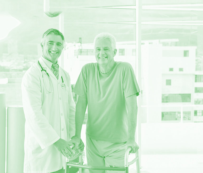 doctor and elderly patient smiling
