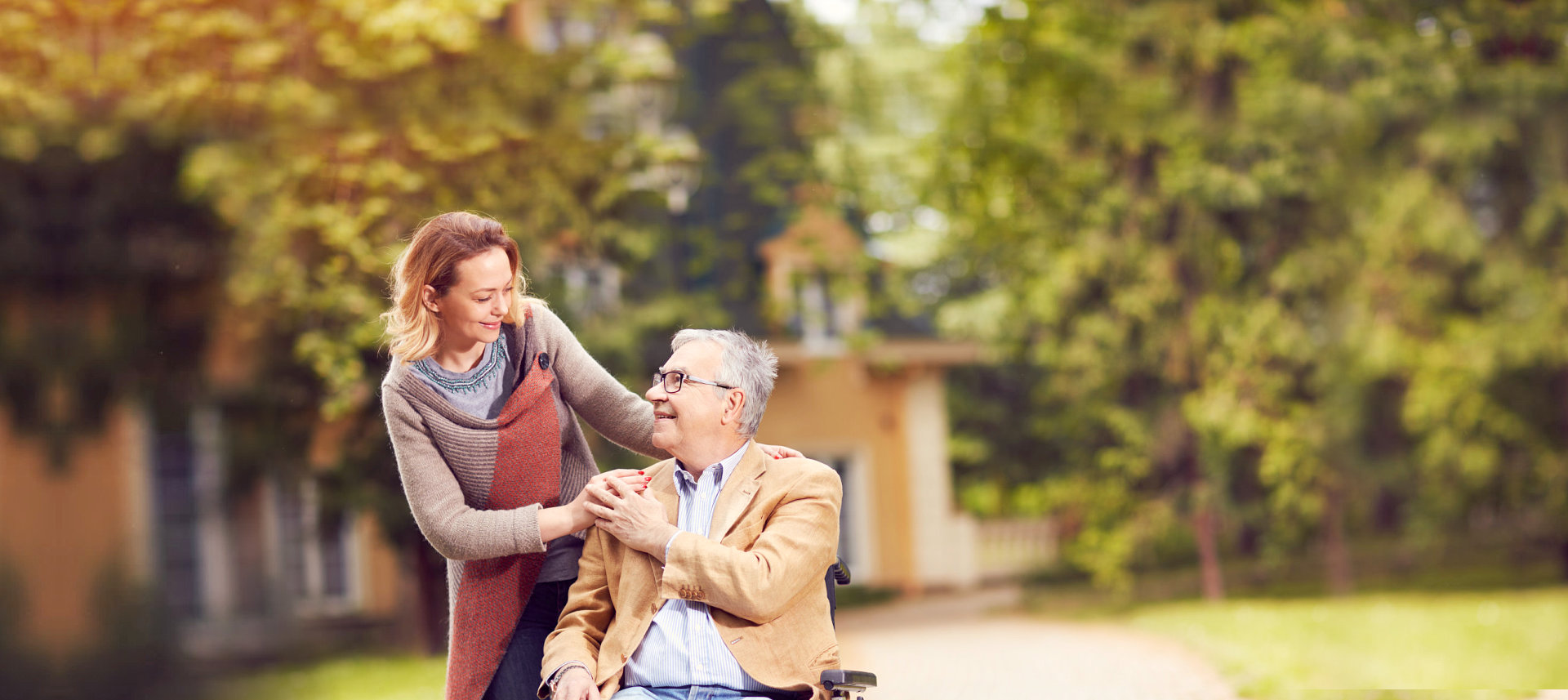 caregiver and elderly man smiling