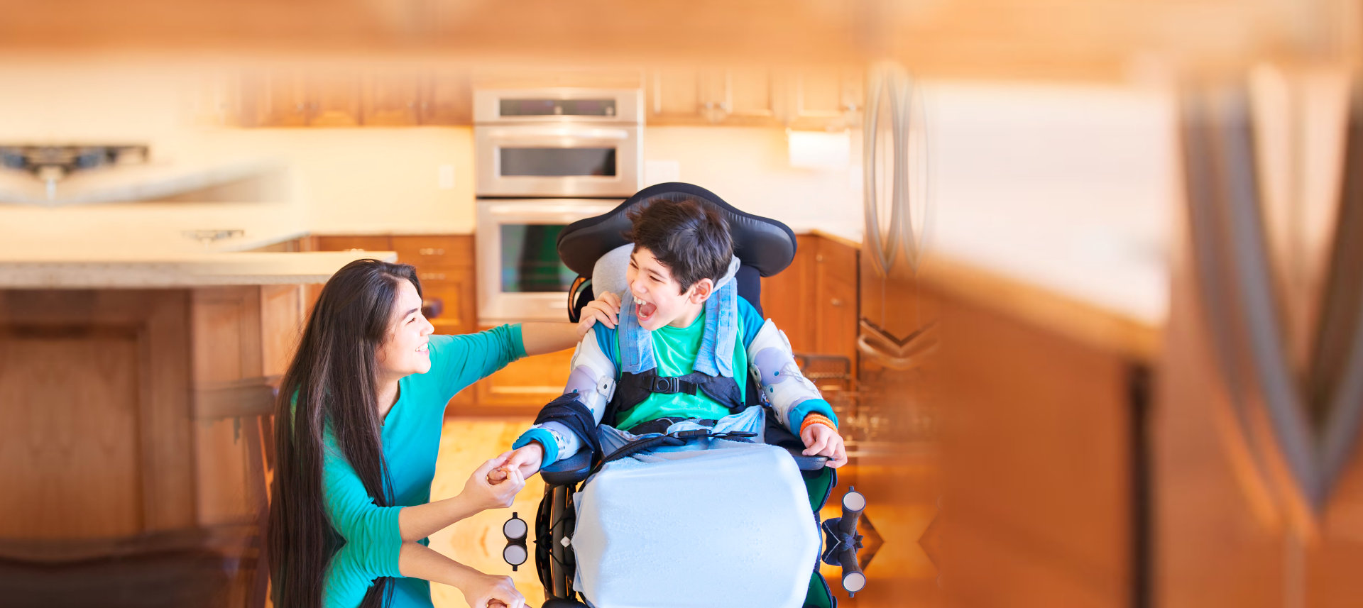 girl and boy with disability smiling